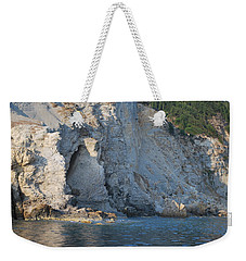 Weekender Tote Bag featuring the photograph Cave By The Sea by George Katechis