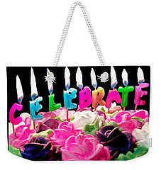 Weekender Tote Bag featuring the photograph Cake Topped With Flowers And Celebrate Candles by Vizual Studio