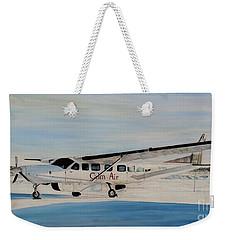 Weekender Tote Bag featuring the painting Cessna 208 Caravan by Marilyn  McNish