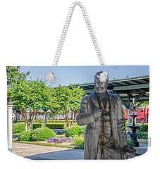 Weekender Tote Bag featuring the photograph Chattanooga Choo Choo Court Yard by Susan  McMenamin