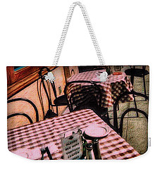 Weekender Tote Bag featuring the photograph Checkered Tablecloths by Nadalyn Larsen