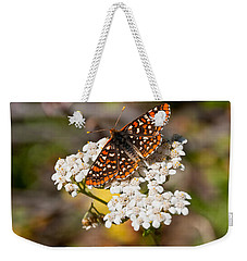 Weekender Tote Bag featuring the photograph Checkerspot Butterfly On A Yarrow Blossom by Jeff Goulden