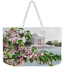 Weekender Tote Bag featuring the photograph Cherry Blossoms And The Jefferson Memorial 2 by Mitchell R Grosky