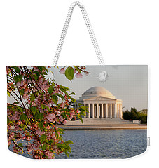 Weekender Tote Bag featuring the photograph Cherry Blossoms And The Jefferson Memorial 3 by Mitchell R Grosky