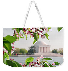 Weekender Tote Bag featuring the photograph Cherry Blossoms And The Jefferson Memorial by Mitchell R Grosky