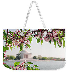 Weekender Tote Bag featuring the photograph Cherry Blossoms And The Jefferson Memorial Panorama by Mitchell R Grosky