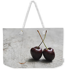 Weekender Tote Bag featuring the photograph Cherry Duo by Jocelyn Friis