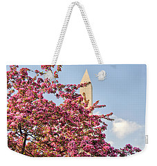 Weekender Tote Bag featuring the photograph Cherry Trees And Washington Monument One by Mitchell R Grosky