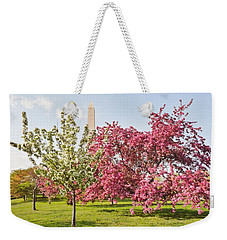 Weekender Tote Bag featuring the photograph Cherry Trees And Washington Monument Three by Mitchell R Grosky