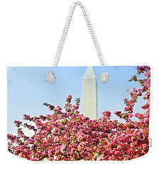Weekender Tote Bag featuring the photograph Cherry Trees And Washington Monument Two by Mitchell R Grosky