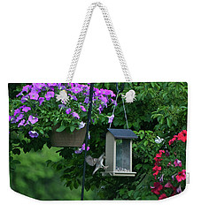 Weekender Tote Bag featuring the photograph Chow Time For This Bird by Thomas Woolworth
