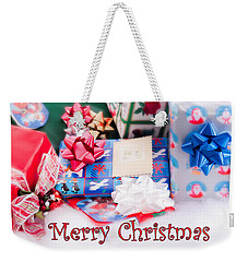 Weekender Tote Bag featuring the photograph Christmas Presents On Artificial Snow by Vizual Studio