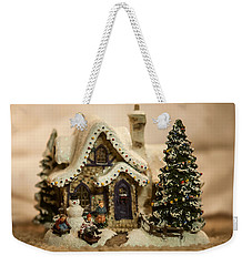 Weekender Tote Bag featuring the photograph Christmas Toy Village by Alex Grichenko