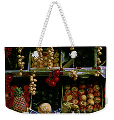 Weekender Tote Bag featuring the photograph Glowing Fruit In Parisian Stand by Tom Wurl