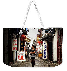 Weekender Tote Bag featuring the photograph City Life In Ancient China by Lucinda Walter