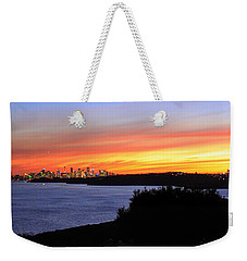 Weekender Tote Bag featuring the photograph City Lights In The Sunset by Miroslava Jurcik