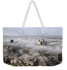 Weekender Tote Bag featuring the photograph City Skyscrapers Above The Clouds by Ron Shoshani
