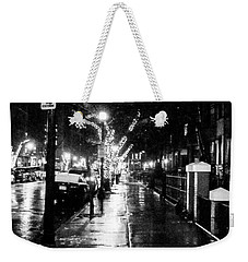 Weekender Tote Bag featuring the photograph City Walk In The Rain by Mike Ste Marie