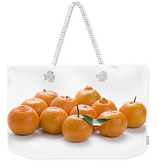 Weekender Tote Bag featuring the photograph Clementine Oranges On White by Lee Avison