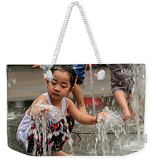 Clothed Children Play At Water Fountain Weekender Tote Bag