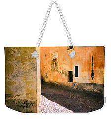 Weekender Tote Bag featuring the photograph Cobbled Street by Silvia Ganora