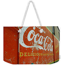 Weekender Tote Bag featuring the photograph Coca-cola On The Army Store Wall by Kathy Barney