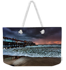 Weekender Tote Bag featuring the photograph Cocoa Sunrise by Steven Reed