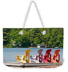 Weekender Tote Bag featuring the photograph Colorful Chairs by Les Palenik