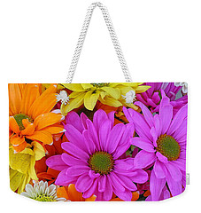 Weekender Tote Bag featuring the photograph Colorful Daisies by Sami Martin