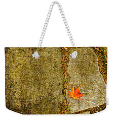 Colorful Fall Leaf On Stone Weekender Tote Bag by Marianne Campolongo