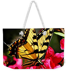 Weekender Tote Bag featuring the photograph Colorful Flying Garden by Nava Thompson