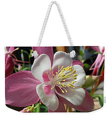 Weekender Tote Bag featuring the photograph Columbine by Caryl J Bohn