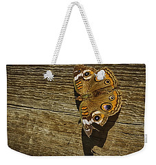 Weekender Tote Bag featuring the photograph Common Buckeye With Torn Wing by Lynn Palmer