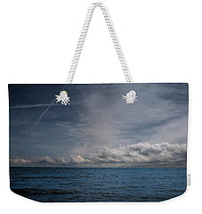 Weekender Tote Bag featuring the photograph Contrails And Rainclouds Over Lake Michigan by John M Bailey
