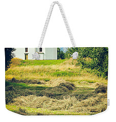 Weekender Tote Bag featuring the photograph Country Church With Hay by Silvia Ganora