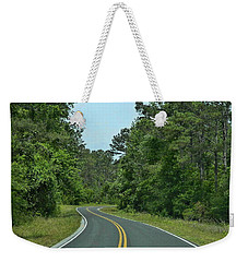 Weekender Tote Bag featuring the photograph Country Road by Victor Montgomery