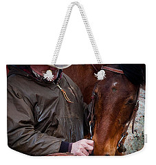 Weekender Tote Bag featuring the photograph Cowboy And His Horse by Steven Reed