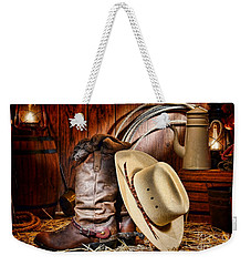 Weekender Tote Bag featuring the photograph Cowboy Gear by Olivier Le Queinec