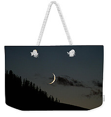 Weekender Tote Bag featuring the photograph Crescent Silhouette by Jeremy Rhoades