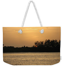 Weekender Tote Bag featuring the photograph Crocodile Eye by Kathy Barney