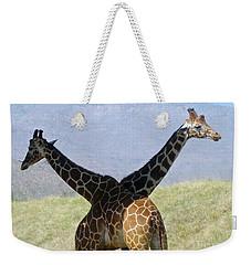 Crossed Giraffes Weekender Tote Bag by Phyllis Kaltenbach