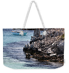 In Cala Pudent Menorca The Cutting Rocks In Contrast With Turquoise Sea Show Us An Awsome Place Weekender Tote Bag