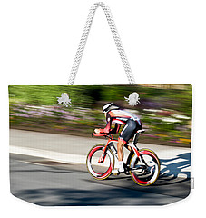 Weekender Tote Bag featuring the photograph Cyclist Racing The Clock by Kevin Desrosiers