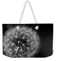Weekender Tote Bag featuring the photograph Dandelion Fluff by Rebecca Davis