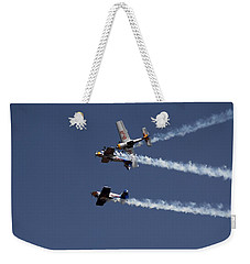 Weekender Tote Bag featuring the photograph Dangerously Close Encounter by Ramabhadran Thirupattur