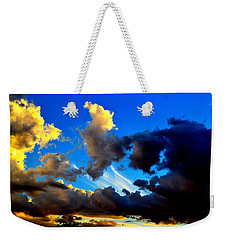 Weekender Tote Bag featuring the photograph Dark And Dusty Skies  by Naomi Burgess