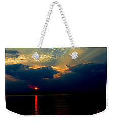 Weekender Tote Bag featuring the photograph Cloudy Sunset by James C Thomas