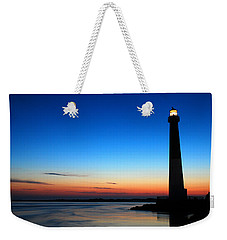 Weekender Tote Bag featuring the photograph Dawn At Barnegat Light by James Kirkikis