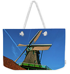 Weekender Tote Bag featuring the photograph De Kat Blue Skies by Jonah  Anderson