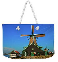 Weekender Tote Bag featuring the photograph De Kat On De Zaan by Jonah  Anderson